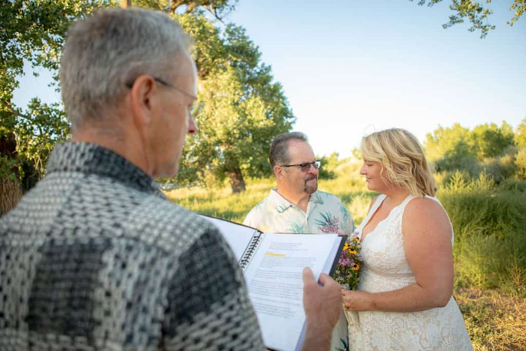 A couple basks in the sunshine while they say their vows in New Mexico