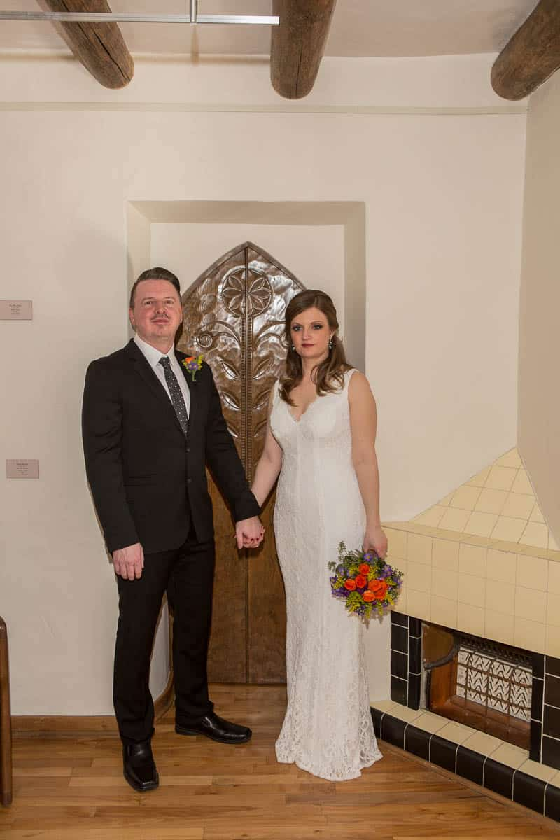 Pose in front of an ornately carved door at your art museum wedding.