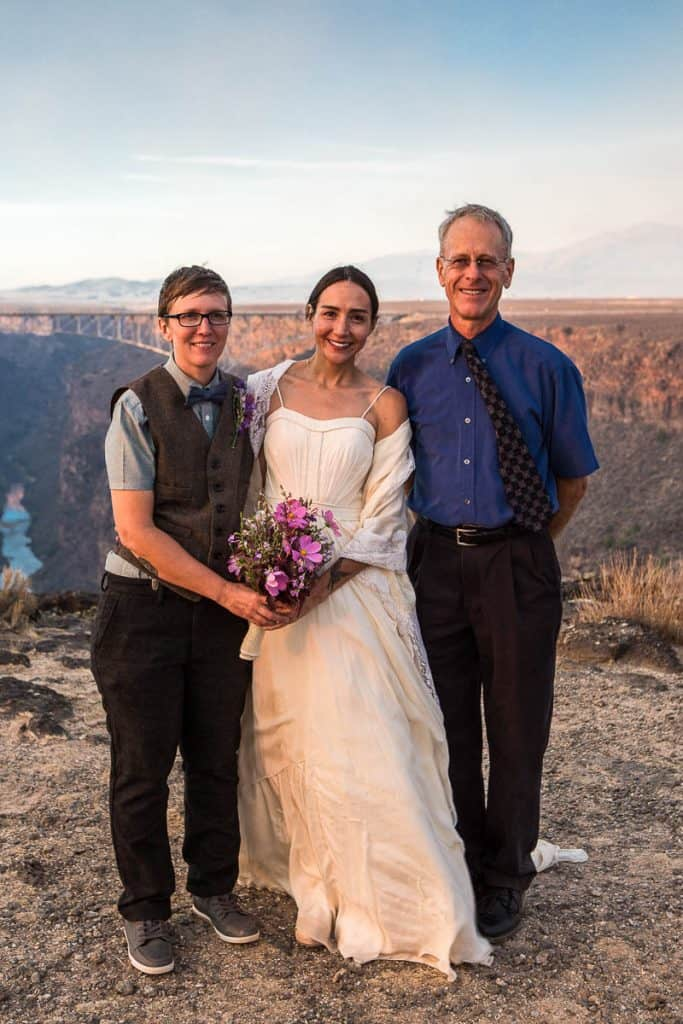 A couple smiling after their ceremony with Dan Jones, at the Rio Grande Gorge Bridge Overlook