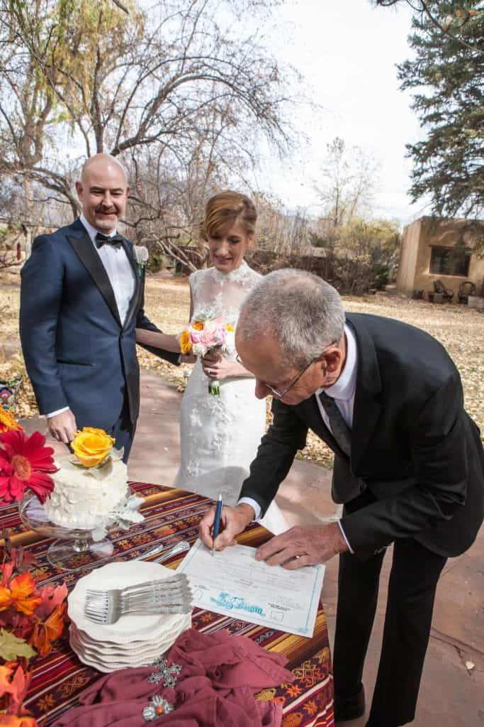 Getting the license signed is one of the tasks of wedding officiant services