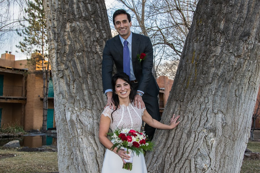 Create a playful moment in one of the giant cottonwoods at El Monte Sagrado, a favorite wedding location in or around Taos.