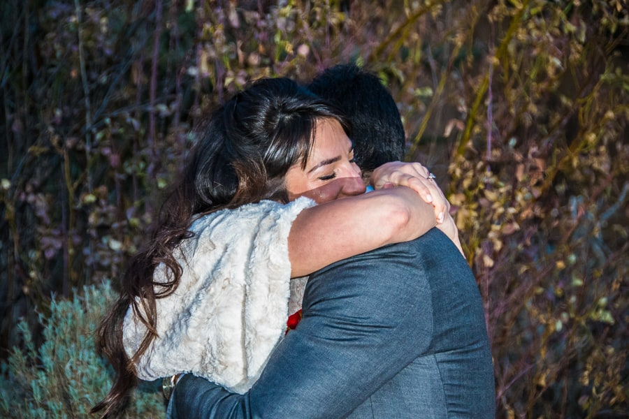 A couple hugs during their intimate elopement ceremony in Taos.