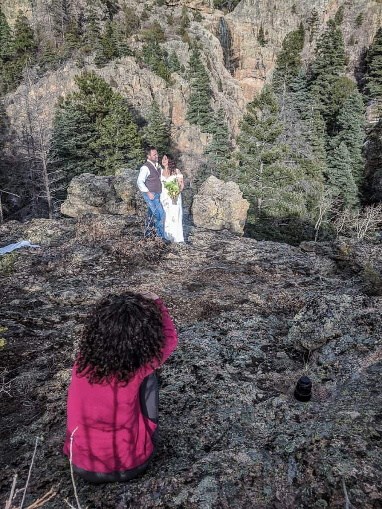 A photographer takes photos of a newly married couple in New Mexico