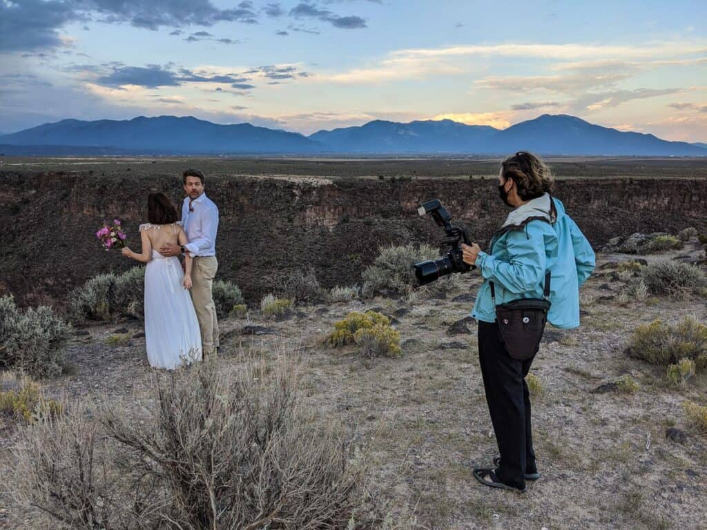 Photographer discussing wedding photos with couple