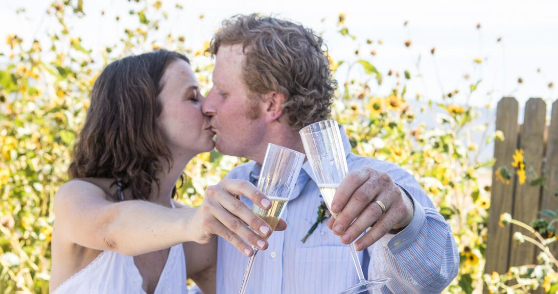 A couple kisses during their champagne toast