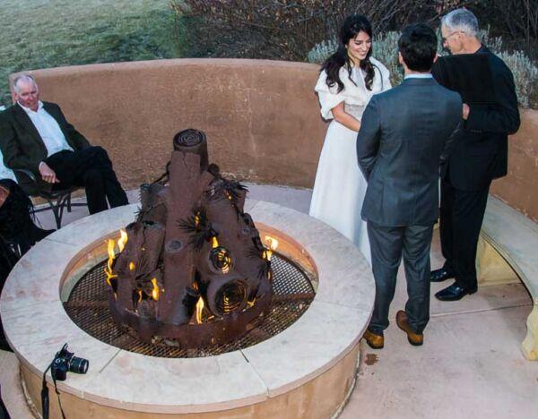 An intimate wedding around the fire pit at El Monte Sagrado in Taos