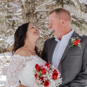 Happy couple at their winter wedding in Taos Ski Valley