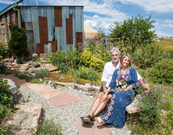 Gardens and natural structures make great backgrounds for wedding portraits.
