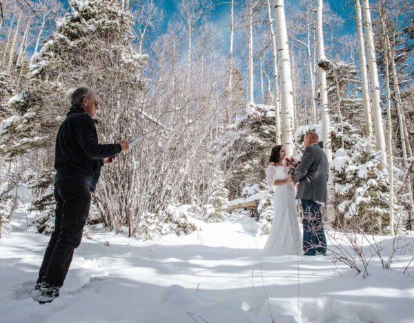 Dan Jones officiates a winter wedding at the Taos Ski Valley