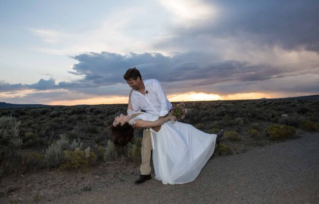 A husband dips his bride after their wedding