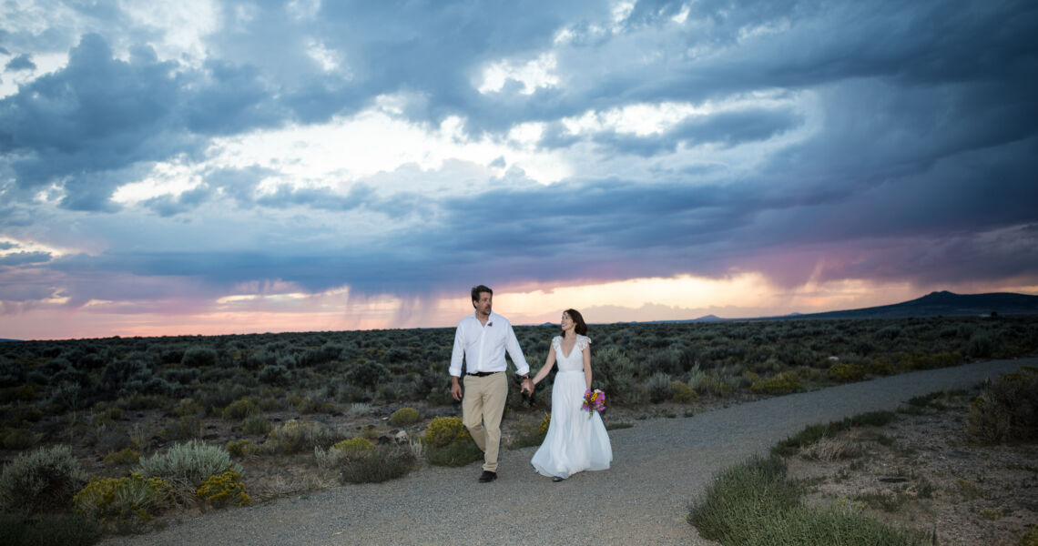 A wedding photo at sunset in the magic Taos light