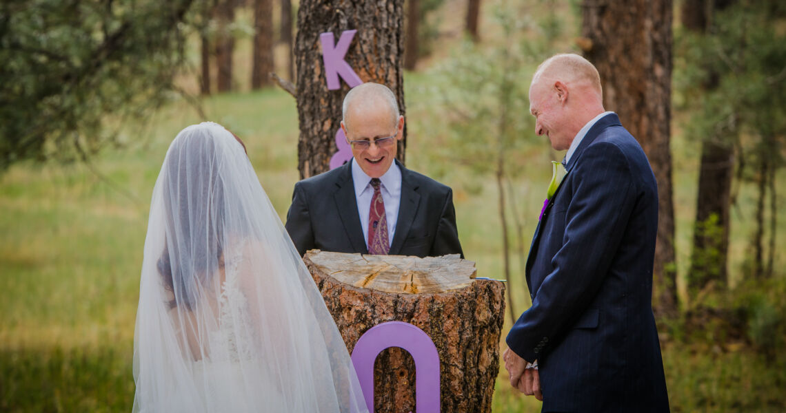 Dan Jones officiating a wedding while keeping the bride and groom relaxed