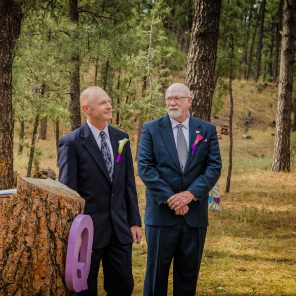 A couple at their same-sex wedding in taos