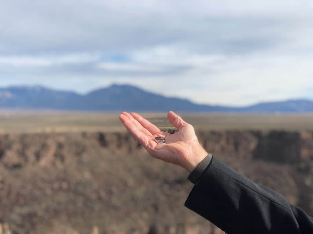 The sacred Taos Mountain frames my hand as I bless the rings