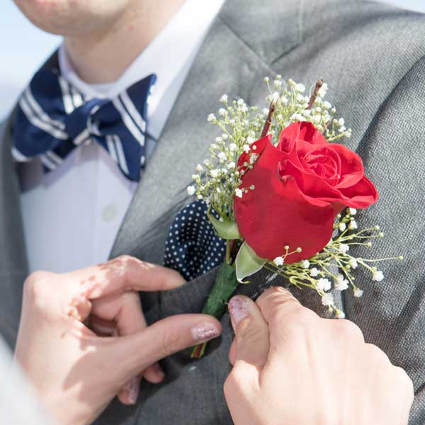 An example of the rose boutonniere that come with the Forever in Love Wedding Package