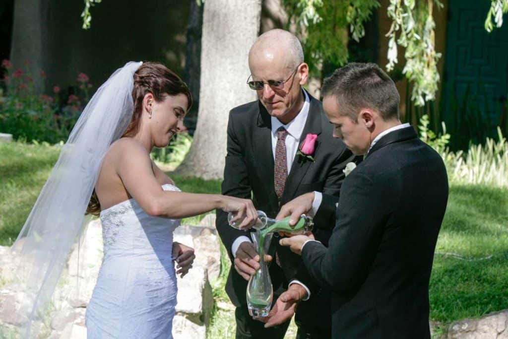 Some rituals work better outdoors than other. Hiring a wedding officiant helps keep you out of trouble!